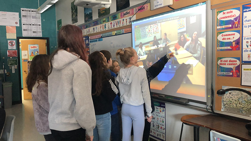 Annette Koerten's 8th grade French students using classroom technology to connect with students in France as part of their pen pal program.