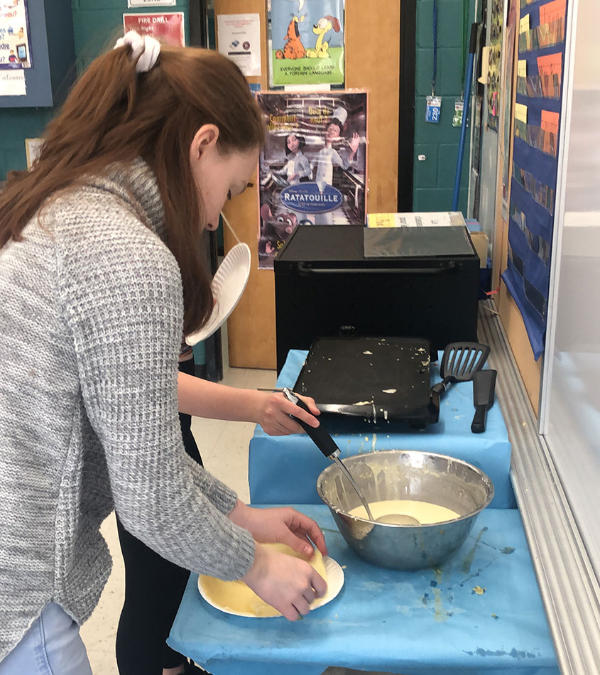 8th Grade French students practicing their cooking.