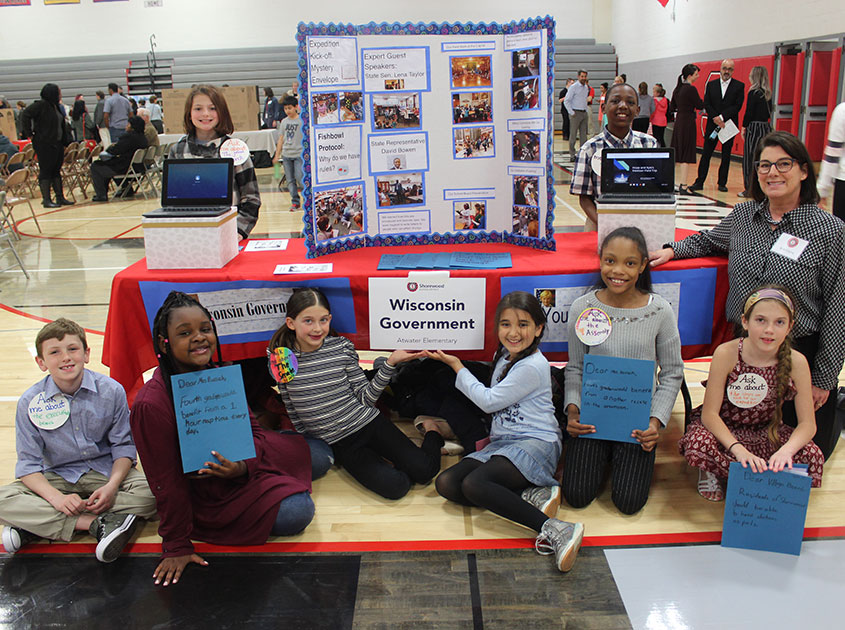 Atwater fourth grade teacher Cris Kryns with some of her students, showing their project at the Authentic Learning Showcase in spring, 2019.